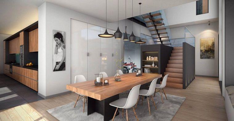 comedor-moderno-abierto-cuadro-candelabros-mesa-madera